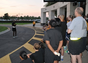DLA Director Army Lt. Gen. Darrell Williams addresses DLA's military service members before leading the group on a 5K run Aug. 4 at the McNamara Headquarters Complex.