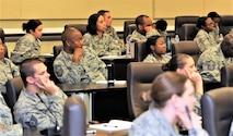 Airmen assigned to Air Force District of Washington listen attentively to mentors sharing their perspectives