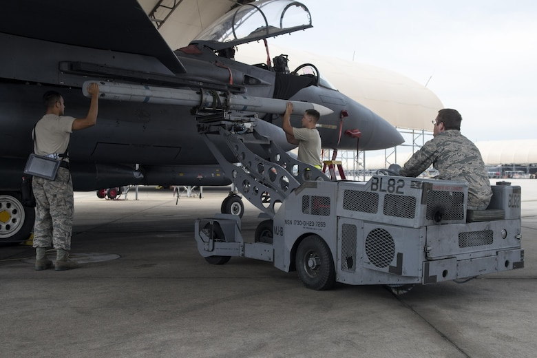 4th Aircraft Maintenance Squadron weapons load crew Airmen arm an F-15E Strike Eagle with an Aim-120 missile in preparation for exercise Combat Hammer, Aug. 3, 2017, at Seymour Johnson Air Force Base, North Carolina. F-15Es were loaded with missiles and bombs before flying to Hill Air Force Base, Utah, to participate in the exercise. (U.S. Air Force photo by Airman 1st Class Shawna L. Keyes)