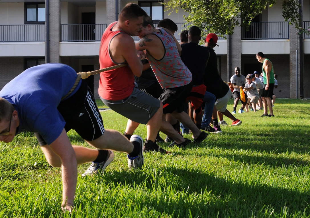 Keesler dorm residents and chief master sergeants play tug-of-war during the 2017 Dorm Bash at the Biloxi Hall courtyard August 1, 2017, on Keesler Air Force Base, Miss. The Dorm Bash was sponsored by the Keesler Chiefs Group to provide an opportunity for Keesler dorm residents to spend time together in fellowship. The chief master sergeants took home the Battle of the Bash Dragon award. (U.S. Air Force photo by Airman 1st Class Suzanna Plotnikov)