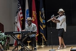Associates perform during talent showcase