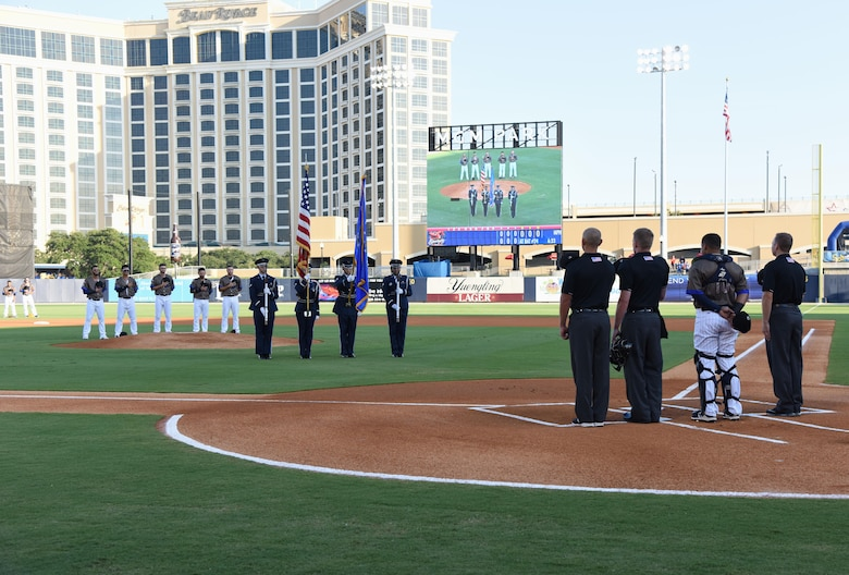 Keesler Air Force Base Honor Guard members present the colors during the Biloxi Shuckers Minor League Baseball team's military appreciation night July 31, 2017, in Biloxi, Miss. The Shuckers recognized and honored service members and their families for serving the nation. (U.S. Air Force photo by Kemberly Groue)