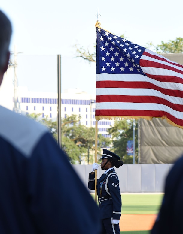 Senior Airman Quontalia Shephard, Keesler Air Force Base Honor Guard member, marches with the U.S. flag during the Biloxi Shuckers Minor League Baseball team's military appreciation night July 31, 2017, in Biloxi, Miss. The Shuckers recognized and honored service members and their families for serving the nation. (U.S. Air Force photo by Kemberly Groue)