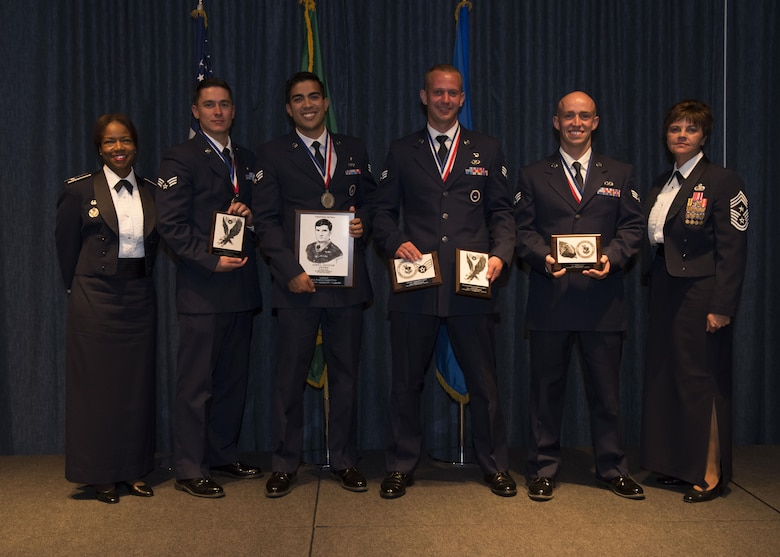 (From left to right) Col. Yvonne Spencer, 92nd Mission Support Group commander, Senior Airman Joshua Kalanick, 92nd Aerospace Medicine Squadron, Senior Airman Patrick Cruz, 22nd Training Squadron, Senior Airman Joseph St. Pierre, 66th Training Squadron, Senior Airman Jesus Ramos, 92nd Aircraft Maintenance Squadron, and Chief Master Sgt. Shannon Rix, 92nd Air Refueling Wing command chief, pose for a top graduate group photo Aug. 1, 2017, at Fairchild Air Force Base, Washington. Airman Leadership School is an educational program designed to develop enlisted Airmen into front-line supervisors.