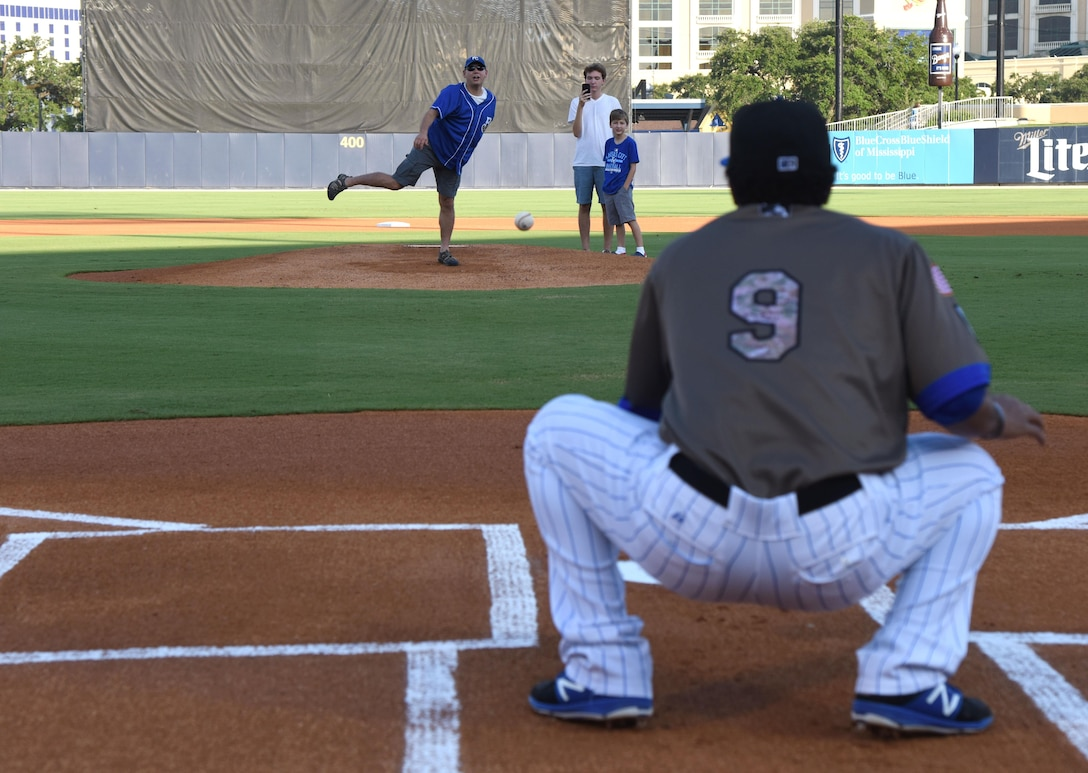 Lt. Col. Jerry Hambright, 81st Communications Squadron commander, throws the first pitch during the Biloxi Shuckers Minor League Baseball team's military appreciation night July 31, 2017, in Biloxi, Miss. The Shuckers recognized and honored service members and their families for serving the nation. (U.S. Air Force photo by Kemberly Groue)