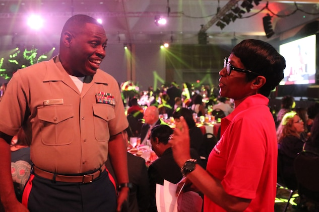 "Master Sgt. Damian Cason, the community engagement chief at Marine Corps Recruiting Command in Quantico, Va., interacts with a volunteer at the National Urban League Women of Power Awards Luncheon in St. Louis, Mo., on July 27, 2017. The theme of this year's National Urban League National Conference was ""Save Our Cities: Education, Jobs and Justice."" (U.S. Marine Corps photo by Sgt. Jennifer Webster/Released)"