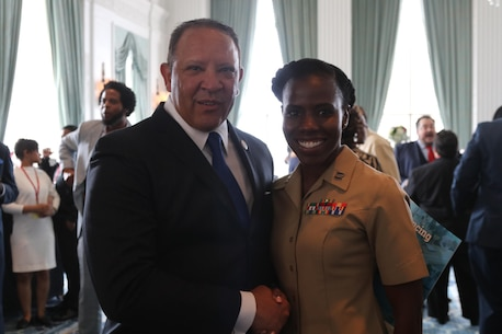 """Captain Charlyne Delus, a Marine Corps officer from Miami, Fl., shakes hands with Mark H. Morial, the National Urban League president and chief executive officer, at the Chairman's Leadership Reception at the Marriott St. Louis Grand Hotel in St. Louis, Mo., on July 27, 2016. The theme of this year's National Urban League National Conference was """"Save Our Cities: Education, Jobs and Justice."""" (U.S. Marine Corps photo by Sgt. Jennifer Webster/Released)"""