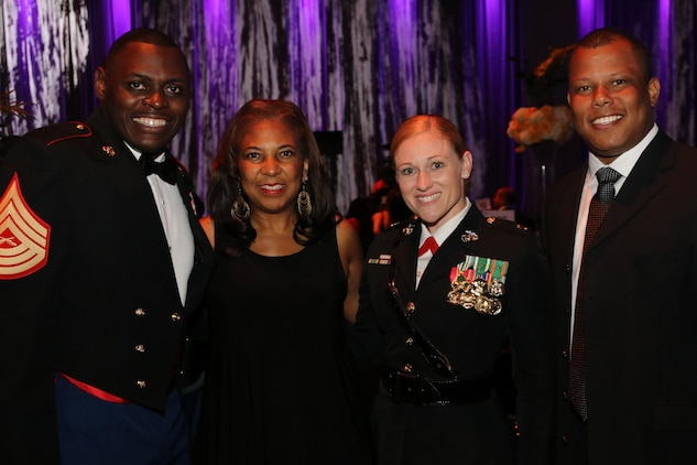 "Master Sgt. Damian Cason, Dr. Eve Hall, Maj. Nicole Bastian and Venton Blandin (pictured left to right) pose for a photo at the Whitney M. Young, Jr. Awards Gala in St. Louis, Mo., on July 28, 2017. The theme of this year's National Urban League National Conference was ""Save Our Cities: Education, Jobs and Justice."" (U.S. Marine Corps photo by Sgt. Jennifer Webster/Released)"