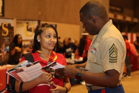 """Marines with Marine Corps Recruiting Command and Recruiting Station St. Louis interact and engage with students at the College Fair during the National Urban League Youth Leadership Summit at the St. Louis Convention Center on July 29, 2017. The theme for this year's Youth Summit was """"Show Me: Turn Talk Into Action."""" (U.S. Marine Corps photo by Sgt. Jennifer Webster/Released)"""