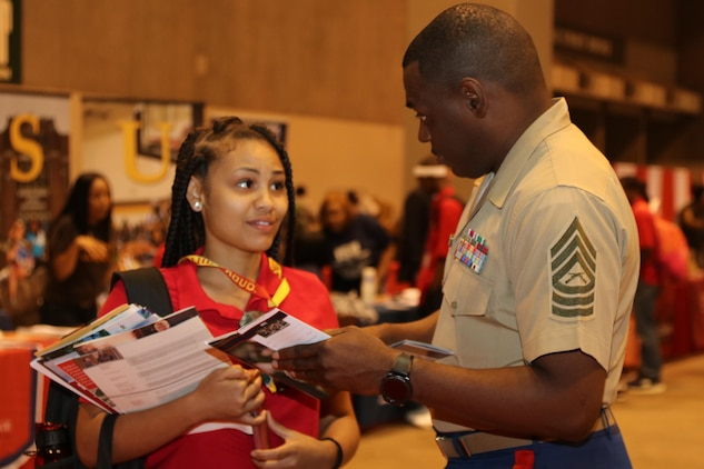 "Marines with Marine Corps Recruiting Command and Recruiting Station St. Louis interact and engage with students at the College Fair during the National Urban League Youth Leadership Summit at the St. Louis Convention Center on July 29, 2017. The theme for this year's Youth Summit was ""Show Me: Turn Talk Into Action."" (U.S. Marine Corps photo by Sgt. Jennifer Webster/Released)"