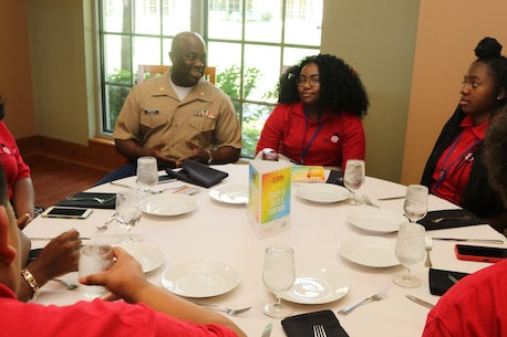 """Marines with Marine Corps Recruiting Command and Recruiting Station St. Louis interact and engage with students at the Youth Legacy of Success Luncheon and Awards Ceremony during the National Urban League Youth Leadership Summit in St. Louis on July 29, 2017. The theme for this year's Youth Summit was """"Show Me: Turn Talk Into Action."""" (U.S. Marine Corps photo by Sgt. Jennifer Webster/Released)"""