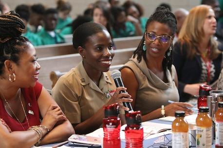 """Captain Charlyne Delus, a Marine Corps officer from Miami, Fl., gives words of feedback to students participating in the Project Ready Case Competition at Washington University in St. Louis. Mo., July 26, 2017. The theme for this year's Youth Summit was """"Show Me: Turn Talk Into Action."""" (U.S. Marine Corps photo by Sgt. Jennifer Webster/Released)"""