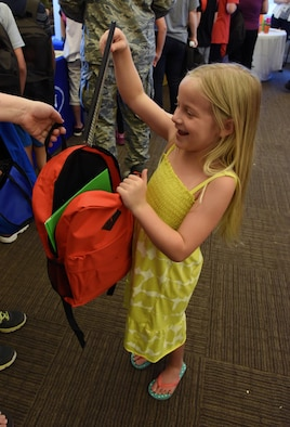 Isabella Tarpley, daughter of Airman Eric Tarpley, 335th Training Squadron student, inspects a notebook in her backpack during a back-to-school event sponsored by Operation Homefront in the Bay Ridge Community Center Aug. 1, 2017, on Keesler Air Force Base, Miss. More than 4,000 items and 300 backpacks were donated to 120 military families. (U.S. Air Force photo by Kemberly Groue)