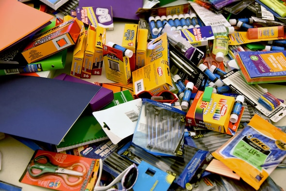 Assorted school supplies sit on display for military families in the Bay Ridge Community Center for a back-to-school event sponsored by Operation Homefront Aug. 1, 2017, on Keesler Air Force Base, Miss. More than 4,000 items and 300 backpacks were donated to 120 military families. (U.S. Air Force photo by Kemberly Groue)