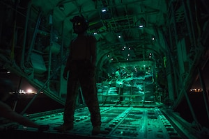 a loadmaster from the 75th Expeditionary Airlift Squadron, waits for a cargo load during a mission in Somalia in support of the Combined Joint Task Force-Horn of Africa