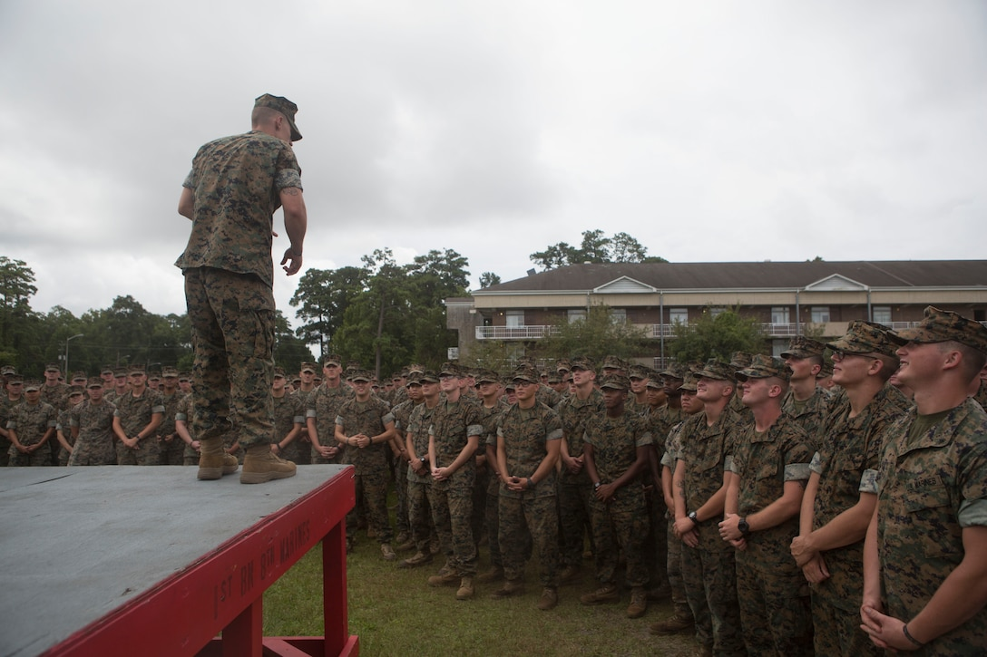 Sgt. Kevin Peach, an infantryman with 1st Battalion, 8th Marine Regiment, delivers the battalion safety brief after being awarded a Navy and Marine Corps Medal during a battalion formation at Camp Lejeune, N.C., Aug. 8, 2017. Peach was awarded for rescuing a man from a burning vehicle on I-5 in California. (U.S. Marine Corps Photo by Sgt. Brandon Thomas)