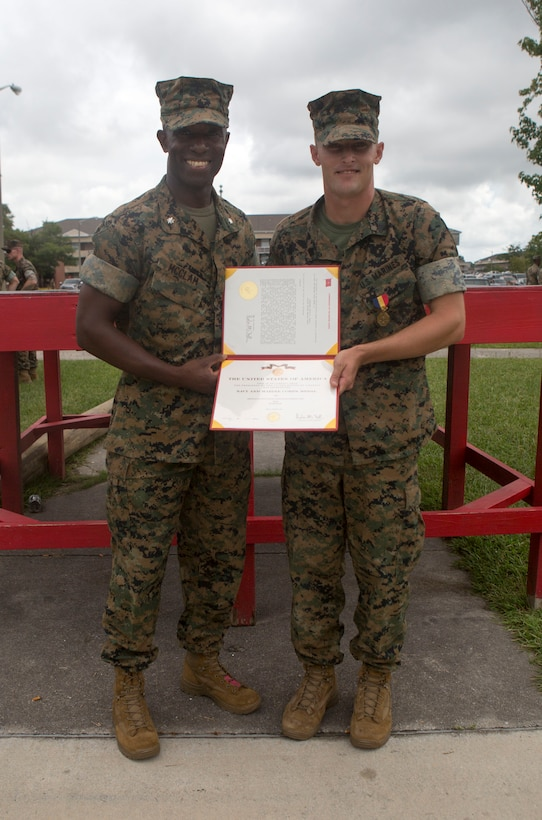 Sgt. Kevin Peach, an infantryman with 1st Battalion, 8th Marine Regiment, was awarded a Navy and Marine Corps Medal by Lt. Col. Reginald McClam, commanding officer of 1st Battalion, 8th Marine Regiment, during a battalion formation at Camp Lejeune, N.C., Aug. 8, 2017. Peach was awarded for rescuing a man from a burning vehicle on I-5 in California.