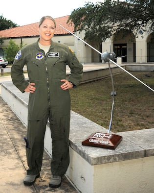 Tech. Sgt. Courtney poses for a photo before the 558th Flying Training Squadron's Undergraduate Remotely Piloted Aircraft Training Course graduation Aug. 4, 2017, at Joint Base San Antonio-Randolph, Texas. Courtney is the first-ever enlisted female to qualify as an RPA pilot. Name badges were blurred due to Air Force limits on disclosure of identifying information for RPA operators. (U.S. Air Force Illustration/Tech. Sgt. Ave I. Young)