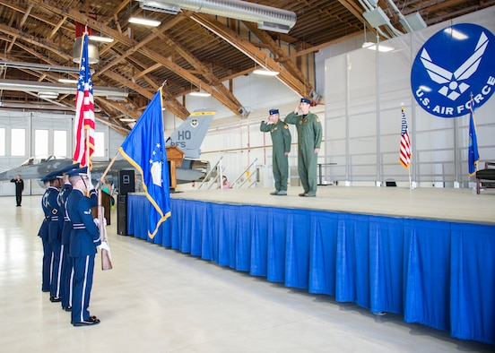 Col. James Keen, 54th Fighter Group commander, and Lt. Col. Mark Sletten, 8th Fighter Squadron commander, present arms for the National Anthem during the 8th FS activation ceremony at Holloman Air Force Base, N.M. Aug. 4, 2017. The 8th FS has been reactivated six years after its last inactivation May 13, 2011. The 8th FS, which was first activated at Selfridge Field, Mich., Jan. 16, 1941, as part of the 49th Pursuit Group, has maintained and piloted various styles of aircraft under an ever-evolving mission. (U.S. Air Force photo by Airman 1st Class Alexis P. Docherty)