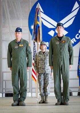 Col. James Keen, 54th Fighter Group commander, and Lt. Col. Mark Sletten, 8th Fighter Squadron commander, stand at attention during the 8th FS activation ceremony at Holloman Air Force Base, N.M. Aug. 4, 2017. The 8th FS has been reactivated six years after its last inactivation May 13, 2011. The 8th FS, with its long-standing history, will now maintain and pilot F-16 fighter jets. According to Sletten, more than 40 F-16 fighter jets are projected to be transported to Holloman, which is almost double the amount of aircraft currently stationed here. (U.S. Air Force photo by Airman 1st Class Alexis P. Docherty)