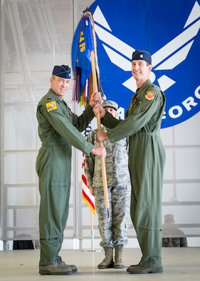 Lt. Col. Mark Sletten, 8th Fighter Squadron commander, is presented command of the 8th FS by Col. James Keen, 54th Fighter Group commander, during an activation ceremony at Holloman Air Force Base, N.M. Aug. 4, 2017. The 8th FS has been reactivated six years after its last inactivation May 13, 2011. The 8th FS, which was first activated at Selfridge Field, Mich., Jan. 16, 1941, as part of the 49th Pursuit Group, has maintained and piloted various styles of aircraft under an ever-evolving mission. (U.S. Air Force photo by Airman 1st Class Alexis P. Docherty)