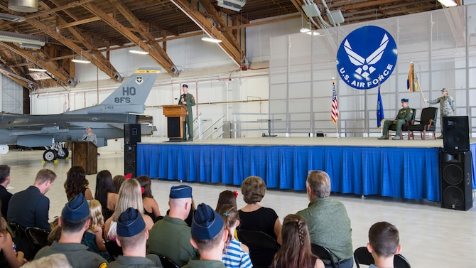 Lt. Col. Mark Sletten, 8th Fighter Squadron commander, gives a speech during the 8th FS activation ceremony at Holloman Air Force Base, N.M. Aug. 4, 2017. The 8th FS has been reactivated six years after its last inactivation May 13, 2011. The squadron will now maintain and pilot F-16 fighter jets, with its sister squadrons, the 311th FS and 314th FS here. (U.S. Air Force photo by Airman 1st Class Alexis P. Docherty)