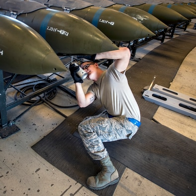 Staff Sgt. Joshua Feekes, 388th Maintenance Squadron Munitions Flight, stencils build codes onto GBU-31 bombs at Hill Air Force Base, Aug. 1. The 2,000-pound bombs will be dropped at the Utah Test and Training Range by Hill AFB's F-35A Lightning II aircraft assigned to the 34th Fighter Squadron during August's Weapons System Evaluation Program. WSEP consists of two parts: Combat Hammer is an air-to-ground weapons evaluation while Combat Archer is an air-to-air weapons evaluation. The F-35As are participating in WSEP for the first time as they move toward Full Warfighting Capability. (Paul Holcomb/U.S. Air Force)
