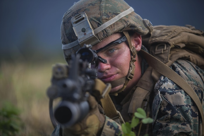 A U.S. Marine with India Company, 3rd Battalion, 3rd Marine Regiment, posts security during a non-combatant evacuation operation (NEO) exercise at Marine Corps Training Area Bellows (MCTAB), July 25, 2017. During a NEO, Marines provide security, evacuate civilians, establish an intermediate support base and operate from naval support platforms at sea. Military personnel with Marine Aircraft Group 24 and 3rd Marines worked together in conducting a NEO which took place at three training areas across Oahu to include MCTAB, Marine Corps Air Station Kaneohe Bay and the Kahuku Training Area. (U.S. Marine Corps photo by Lance Cpl. Matthew Kirk)