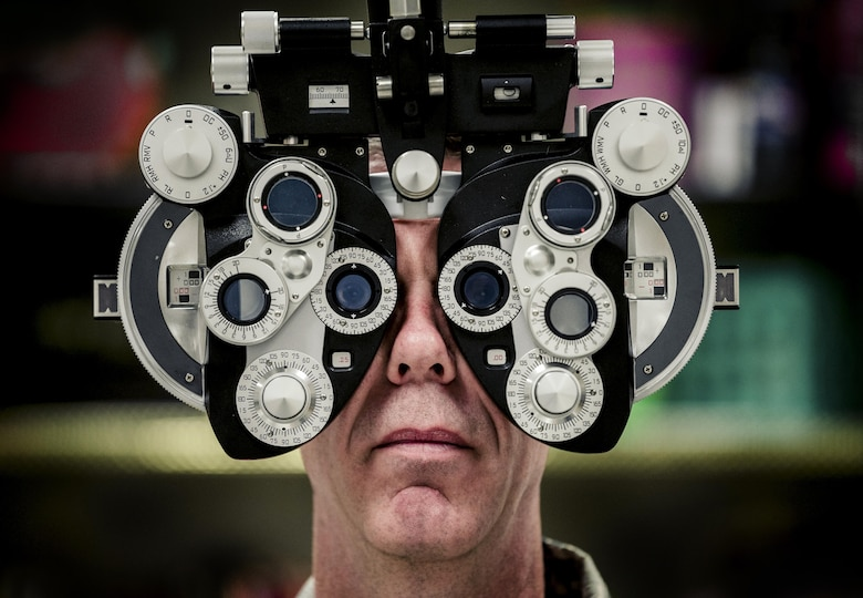 Lt. Col. David Miller, an optometrist assigned to the 442d Medical Squadron at Whiteman Air Force Base, Mo., assists in setting up a phoropter, which was used to give eye exams in Hayesville, N.C., Aug. 1, 2017. The Innovative Readiness Training program meets training requirements for active, reserve and National Guard members and units while addressing public and society needs. (U.S. Air National Guard photo by Staff Sgt. Ryan Campbell)