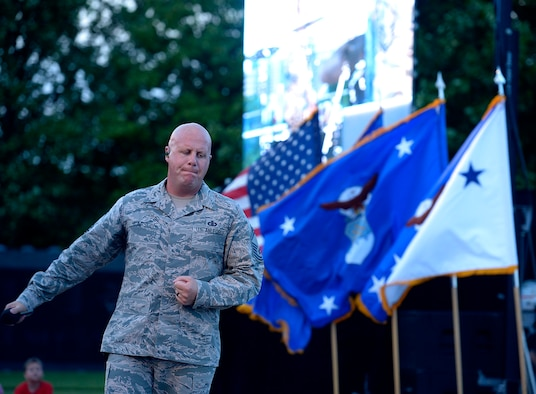 Air Force Bandsman Senior Master Sgt. Ryan Carson performs in honor of the Portraits in Courage Airmen during the final 2017 Heritage to Horizons summer concert series, in Arlington, Va., Aug. 4, 2017. (U.S Air Force photo/Senior Airman Rusty Frank)