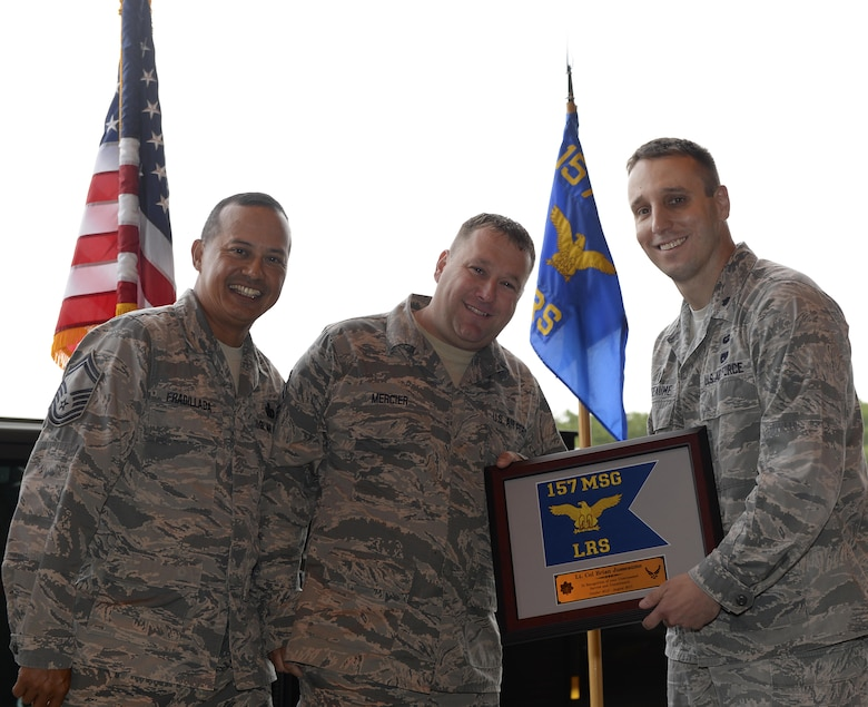 Outgoing LRS commander receives plaque for his service. U.S. Air National Guard Lt. Col. Brian R. Jusseaume, the outgoing 157th Logistic Readiness Squadron commander, receives a plaque for his service from Senior Master Sgts. Gil P. Fradillada, the 157th Maintenance Group materiel management flight superintendent, and Jeremy L. Mercier, the 157th Mission Support Group small air terminal superintendent, on August 5, 2017, at Pease Air National Guard Base, N.H.