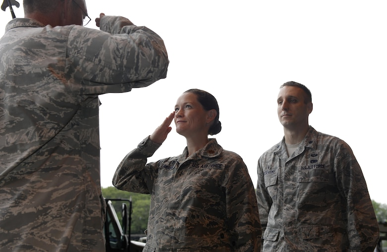 U.S. Air National Guard Maj. Emily C. Lawrence, salutes U.S. Air National Guard Lt. Col. Paul N. Loiselle, the mission support group commander, during a change of command ceremony August 5, 2017, at Pease Air National Guard Base, N.H.
