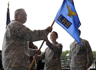 U.S. Air National Guard Maj. Emily C. Lawrence, receives the guidon from U.S. Air National Guard Lt. Col. Paul N. Loiselle, the mission support group commander, during a change of command ceremony August 5, 2017, at Pease Air National Guard Base, N.H. Lawrence assumed command of the 157th Logistics Readiness Squadron. (U.S. Air National Guard photo by Staff Sgt. Kayla Rorick)