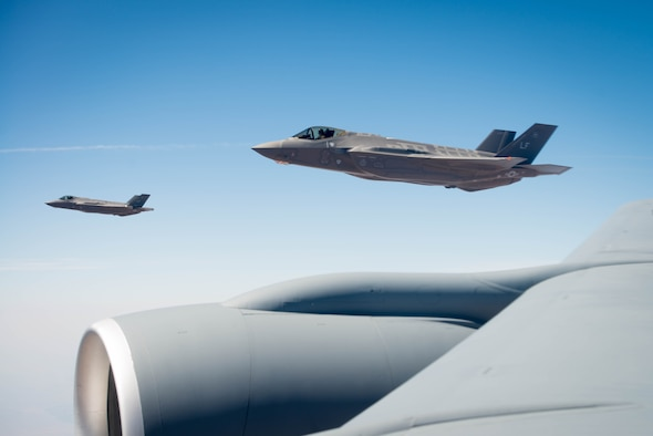 Two F-35A Lighting IIs assigned to the 62nd Fighter Squadron, Luke Air Force Base Ariz, fly near an Arizona National Guard KC-135 Stratotanker Aug. 4, 2017. Four F-35's participated in a missing man formation fly-over during WWII pilot 2nd Lt. Charles E. Carlson's funeral in Pennsylvania more than 70 years after being shot down over Germany in World War II when he was assigned to the 62 FS. (U.S. Air Force photo/Staff Sgt. Jensen Stidham)