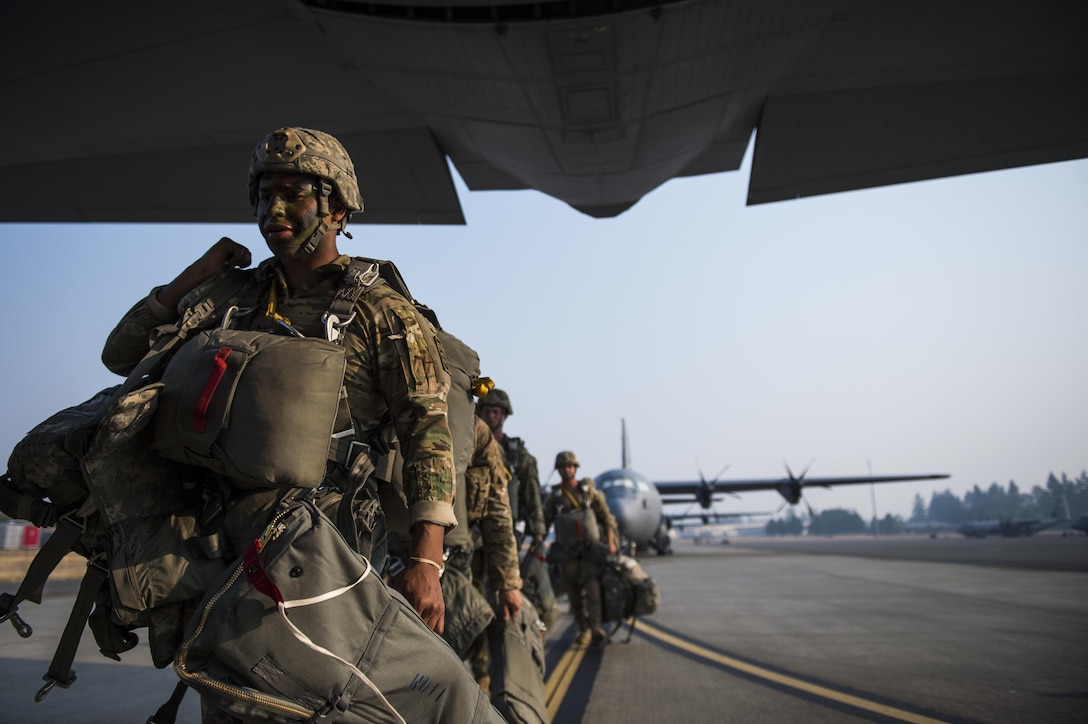 Soldiers boarding a C-130J for an air drop