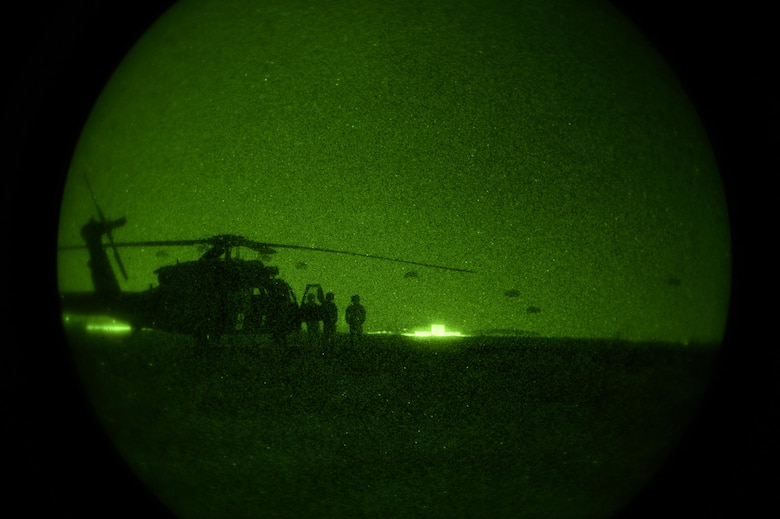 Night vision goggles view of helicopter and 82nd Airborne Division paratroopers