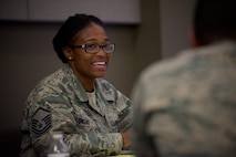 Master Sgt. Barbara Owens, 932nd Airlift Wing Force Support Squadron, listens to Command Chief Master Sgt. Chad Welch speak about his military experience at the unit's speed mentoring session on August 3, 2017.  The event took place at the end of a two day special seminar as part of the wing's force development program at Scott Air Force Base, near Belleville, Ill. They work together during the drill weekends as part of an energized team at the 932nd Airlift Wing. The C-40C flying unit is part of 22nd Air Force, under Air Force Reserve Command. (U.S. Air Force photo by Tech. Sgt. Christopher)