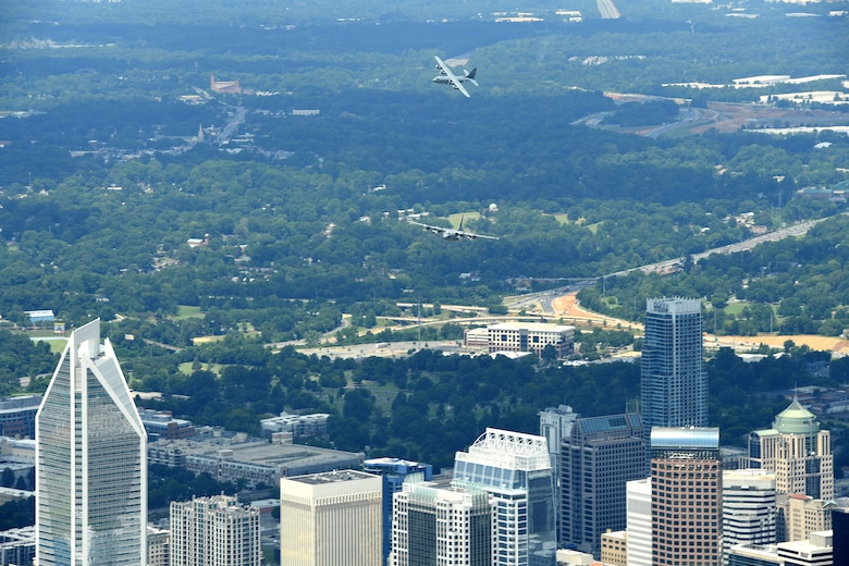 C-130 Aircraft fly above the city of Charlotte