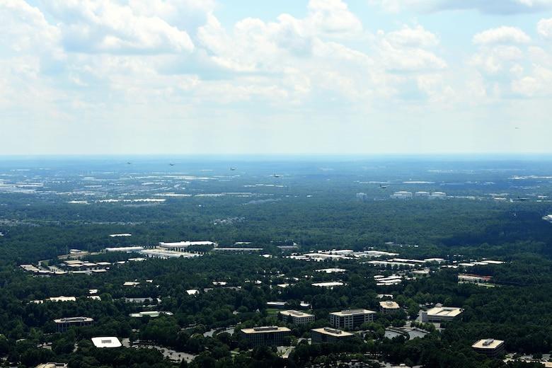 8 C-130 Aircraft fly over North Carolina