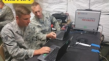 Intelligence Analysts Staff Sgt. Donovan Mattea and Tech. Sgt. Kelly Wiemann both of the 960th Network Warfare Flight, discuss network traffic while embedded within the 35th Combat Communications Squadron's simulated deployed environment at Homestead Air Reserve Base, Fla.