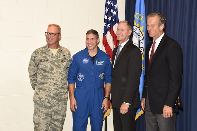 Colonel Michael Hopkins, NASA Astronaut, posed for a photo with Brig. Gen. Joel De Groot, SDNG assistant adjutant general for air, Gov. Dennis Daugaard, and U.S. Sen. John Thune here, Aug. 4.  Hopkins shared his experiences as an astronaut with members of the 114th Fighter Wing.  (U.S. Air National Guard photo by Master Sgt. Christopher Stewart/Released)