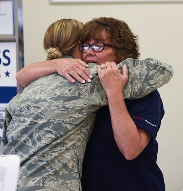 Sherri Oster, Sioux Falls Base Exchange store manager, hugged an Airman of the 114th Fighter Wing at her last unit training assembly, Aug. 6, 2017, Joe Foss Field, S.D. For 26 years, Oster has remained a constant presence at the South Dakota Air National Guard, but she is now preparing for her retirement on Aug. 11, 2017. (U.S. Air National Guard photo by Staff Sgt. Duane Duimstra/Released)