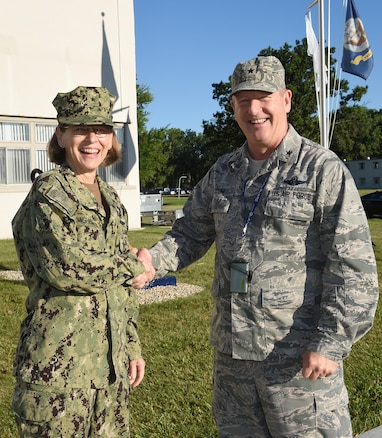 Brig. Gen. John D. Slocum, commander of the 127th Wing and Selfridge Air National Guard Base, Mich., greets Rear Adm. Linnea Sommer-Weddington, Deputy Director for U.S Strategic Command, Offutt Air Force Base here on August 5, 2017.