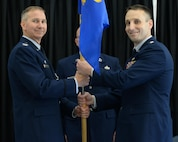 U.S. Air National Guard Col. James P. Ryan, 157th Air Refueling Wing commander, passes a guidon to Lt. Col. Brian R. Jusseaume during the 157th Maintenance Group change of command ceremony on Aug. 5, 2017, at Pease Air National Guard Base, N.H. Lt. Col. Paul M. Kell relinquished command of the 157th Maintenance Group to Jusseaume. (U.S. Air National Guard photo by Staff Sgt. Curtis J. Lenz)