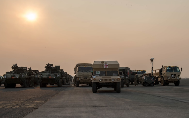 armored vehicles on flightline