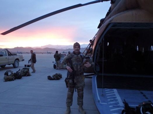 Then Capt. Ryan Harrah poses with a Mil Mi-17 Russian helicopter in 2014. (courtesy photo)