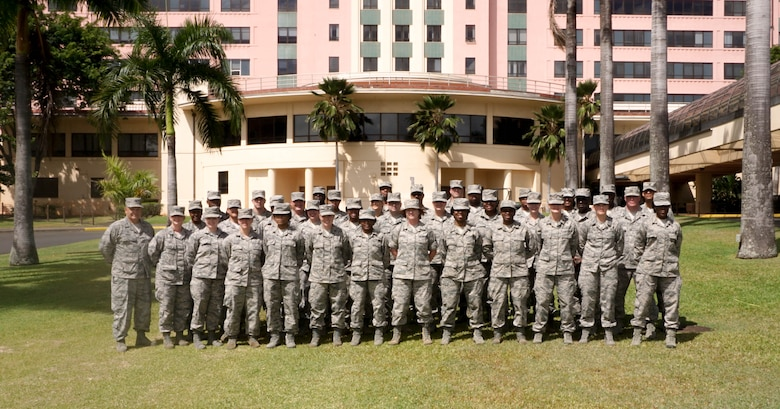 Members of the 164th Medical Group pose for a group photo in front of the Tripler Medical Center, Honolulu. Members of the 164th MDG conducted their annual training July 8-22 2017, Honolulu.(