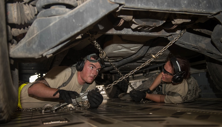 Airmen working on vehicles