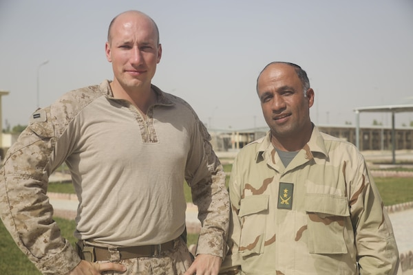 U.S. Marine Capt. Robert Walters, left, an advisor with Task Force Southwest, and Afghan National Army Lt. Col. Mirzashah Sadaq, right, the air officer of the 215th Corps, pose for a photo at Camp Shorabak, Afghanistan, Aug. 5, 2017. On July 24, two Mi-17s completed a casualty evacuation in the Nawa district of Helmand province in support of Operation Maiwand Four. Afghan National Army soldiers with 215th Corps successfully planned and prepared for potential CASEVACs during the operation with assistance and support from U.S. Marine advisors assigned to Task Force Southwest. The Afghan forces extracted the wounded soldier from the battlefield within an hour of notification, which allowed for quicker medical care and saved the soldier's life. (U.S. Marine Corps photo by Sgt. Lucas Hopkins)