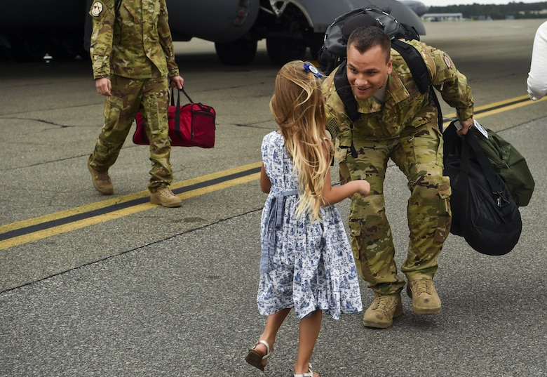 Tech. Sgt. Jason Fatjo, 14th Airlift Squadron loadmaster, greets his daughter after returning from a deployment at Joint Base Charleston, S.C., Aug. 8, 2017.